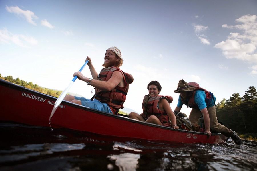 thru-hikers canoe across the kennebec river in maine, the only offical way across
