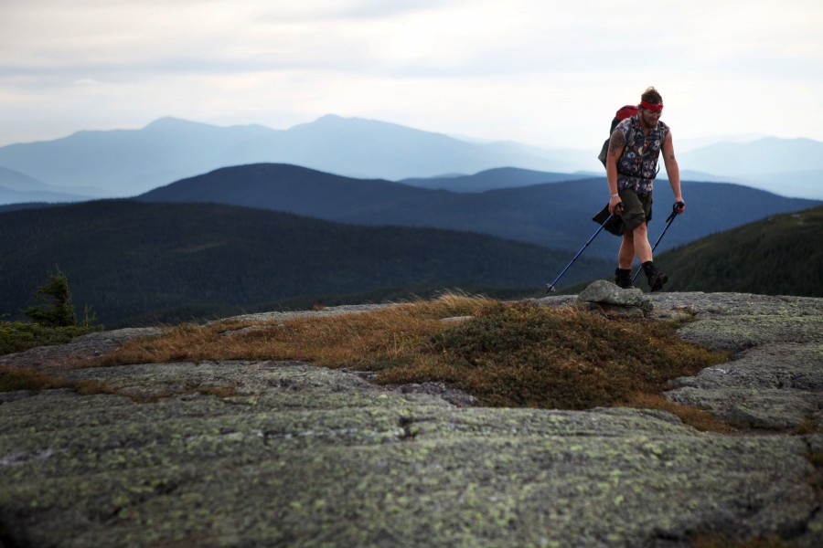 Wes 'Bearbait' mayeux sumits a rocky mountain in Maine