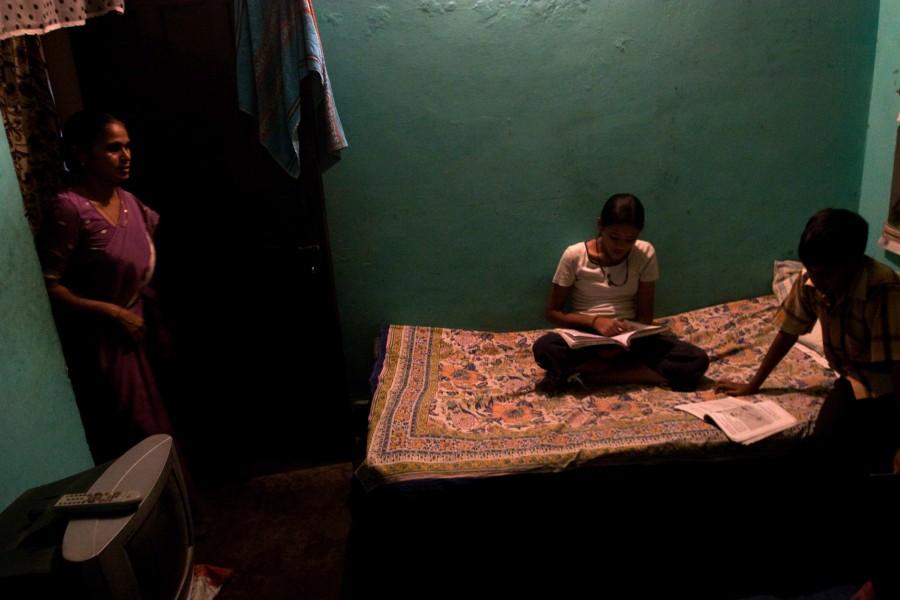 Gudi arrives home to her three children doing their homework after school.