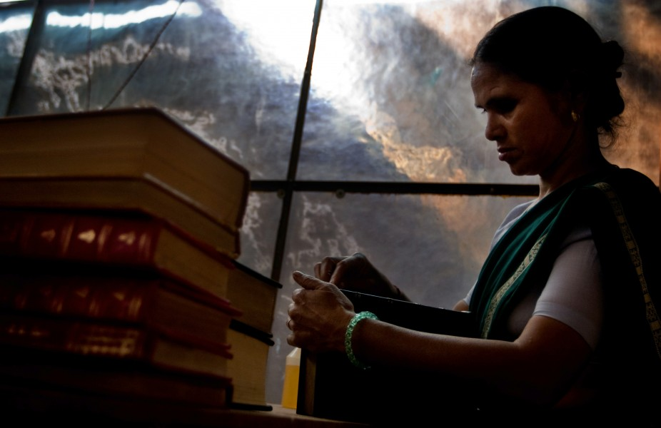 Gudi polishes a leather book in the factory where she works in New Delhi India