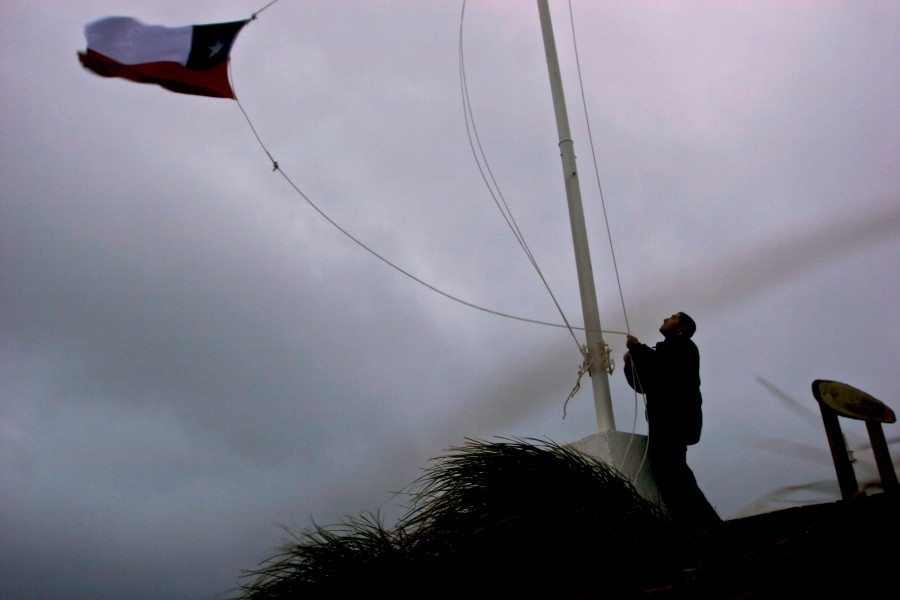 Carlos Heredia changes the flag on Cape Horn, Chile, due to damaging winds.
