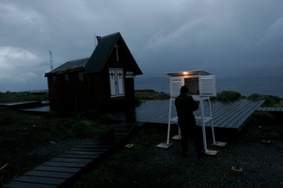 Carlos Heredia checks weather instruments housed outside the lighthouse on Cap Horn, Chile
