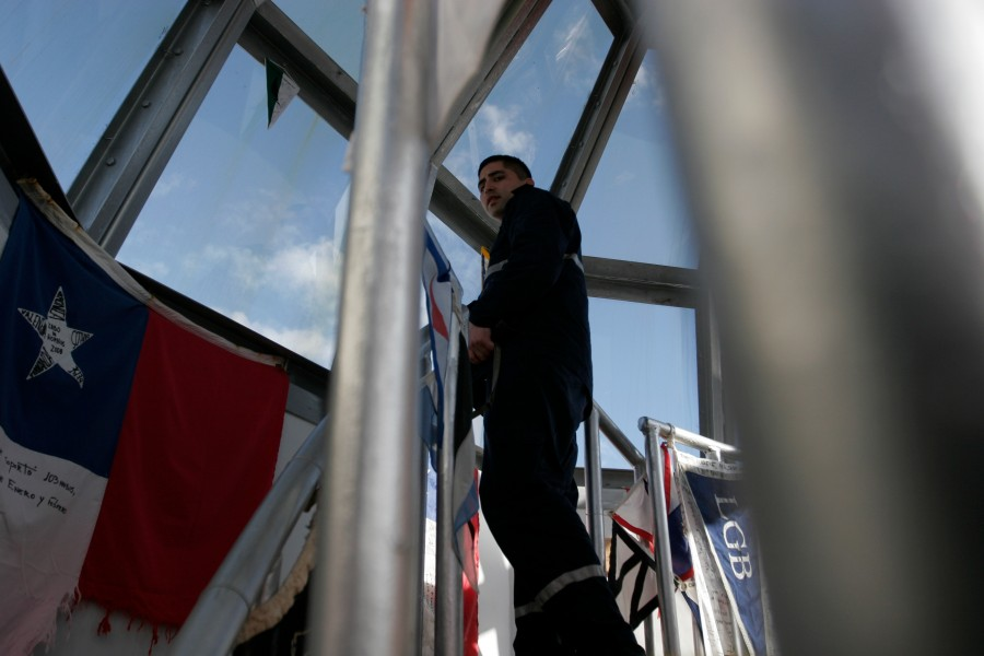 Carlos Heredia, the lighthouse keeper, inspects the inside of the lighthouse.
