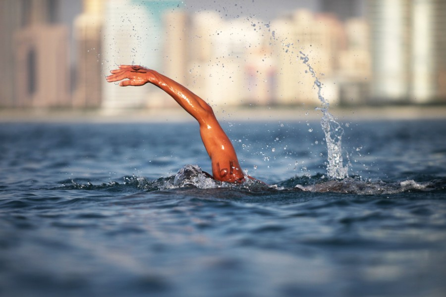 United Arab Emirates - Abu Dhabi - Swimmers from around the world participate in a 15 kilometer open water race starting at Abu Dhabi Marina and running along the Corniche.