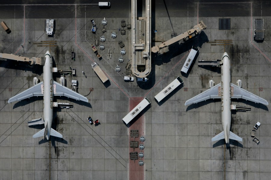 Two Etihad Airlines passenger jets sit on at their gates a Abu Dhabi International Airport in the United Arab Emirates.
