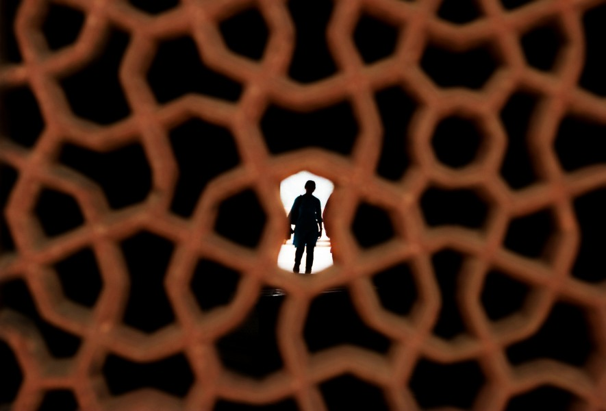 A woman stands in the entrance of a chamber in Humayun's Tomb in New Delhi India