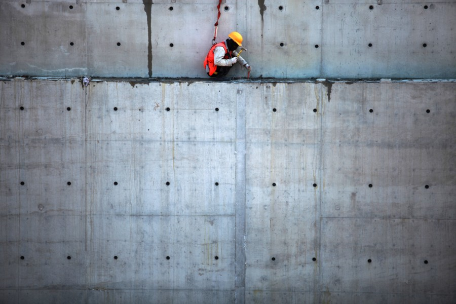 A worker works on the very first section of tunnel wall to be installed in the contract one section of the Salam Street construction, the Mina Road portion of the tunnel.
