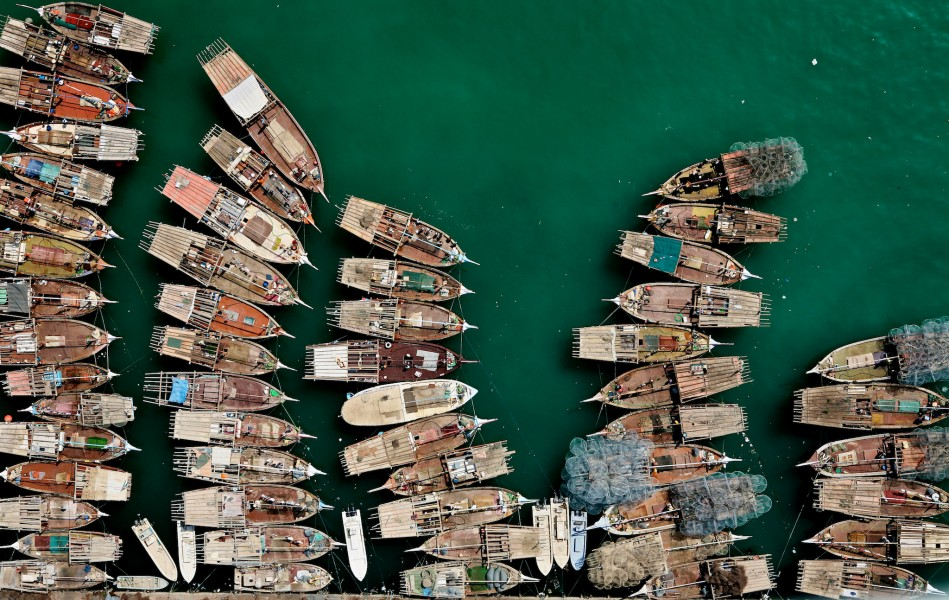 Dhow boats crowd the docks of Abu Dhabi. Aerial