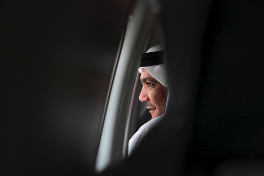 A man wearing traditional arab dress looks out the window of a Fly Dubai passenger jet on their inaugural flight to Erbil, Iraq.