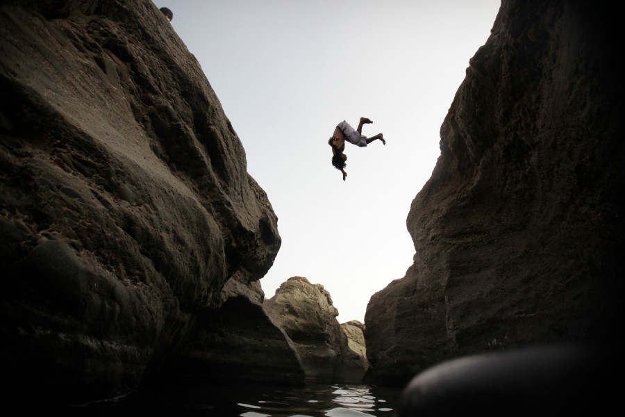 Visitors to Hatta pools jump off the cliffs and into the water below. UAE
