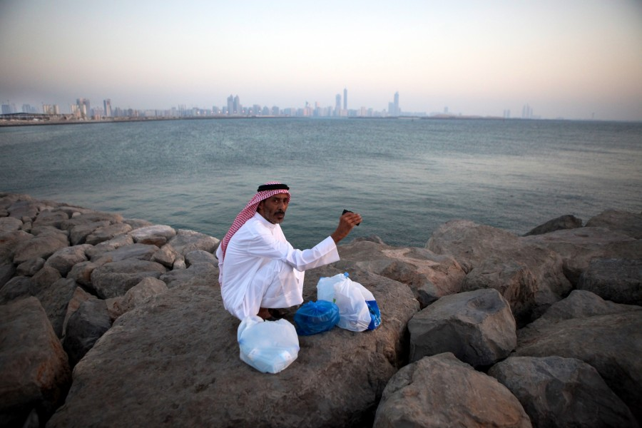 A man looks out from the breakwaters of Abu Dhabi, United Arab Emirates for the moon to mark the end of Ramadan, the Islamic holy month.