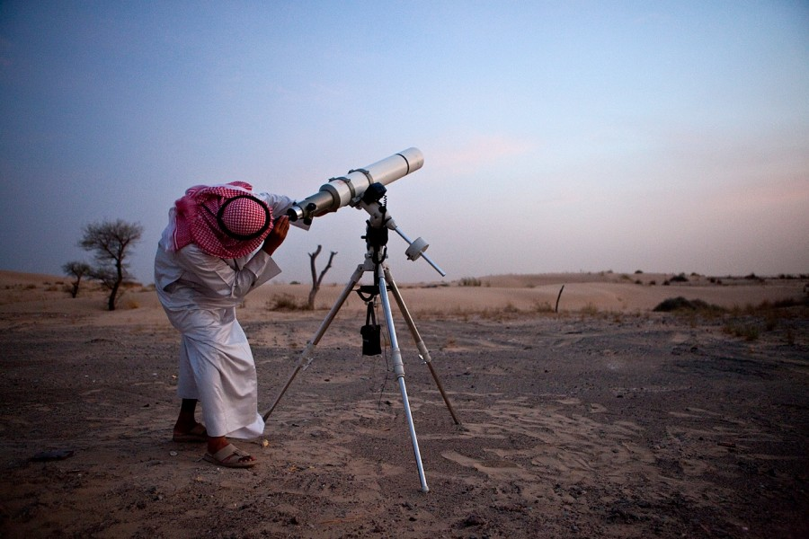 Hasan Hariri, a member of the official moon spotting team, uses his telescope to look for the moon to signal the start of Ramadan.