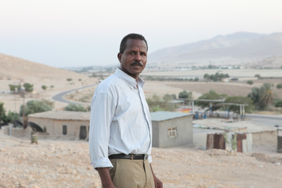 Ahmed Saeed stands outside his home along the Jordan River in Jiftlik, Palestine.