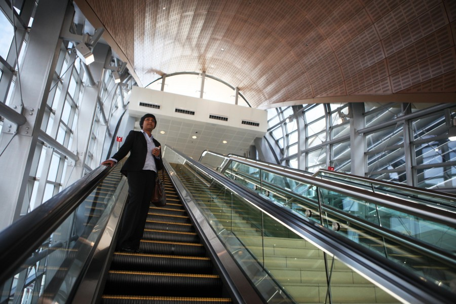 United Arab Emirates, Dubai, Chitra Jayabalan exits the metro station on her way to work.