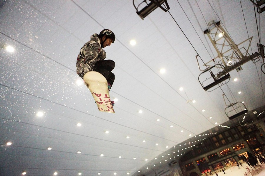 RJ Murphy grabs the bottom of his snowboard in mid air at the indoor ski slope, Ski Dubai, United Arab Emirates