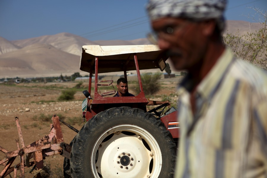a tractor and a farmer in Palestine